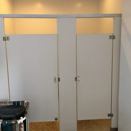 HOA Poolhouse Bathroom Stalls After - Master Remodelers Tx